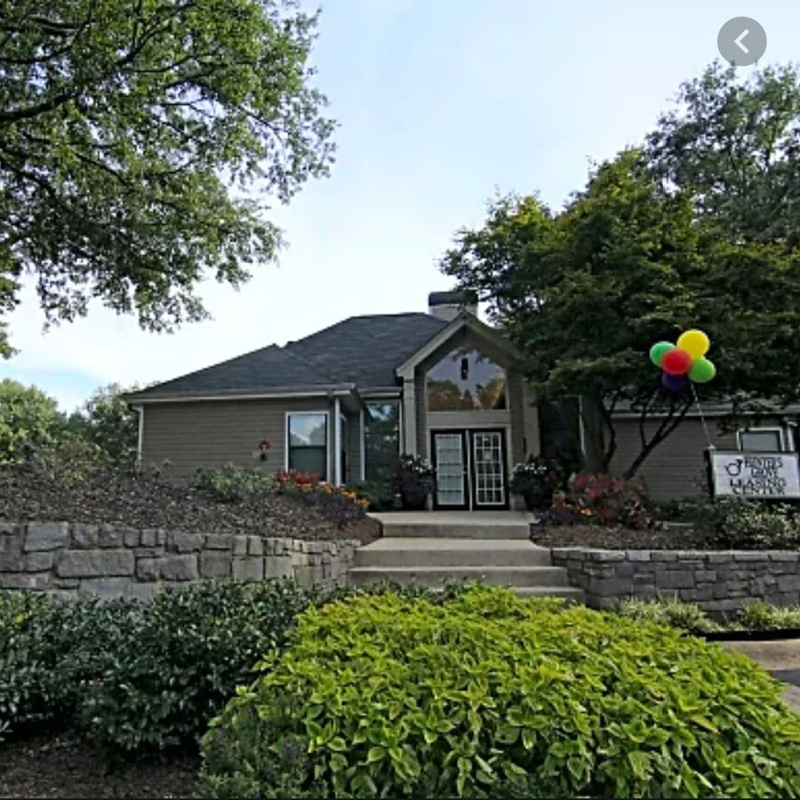 Nice quality apartment clubhouse with green bushes near Six Flags