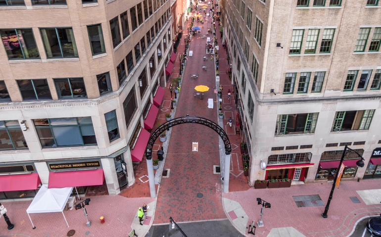 Drone shot of downtown pedestrian cooridor between two buildings